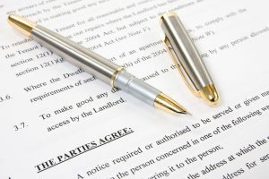 written renting contract with pen