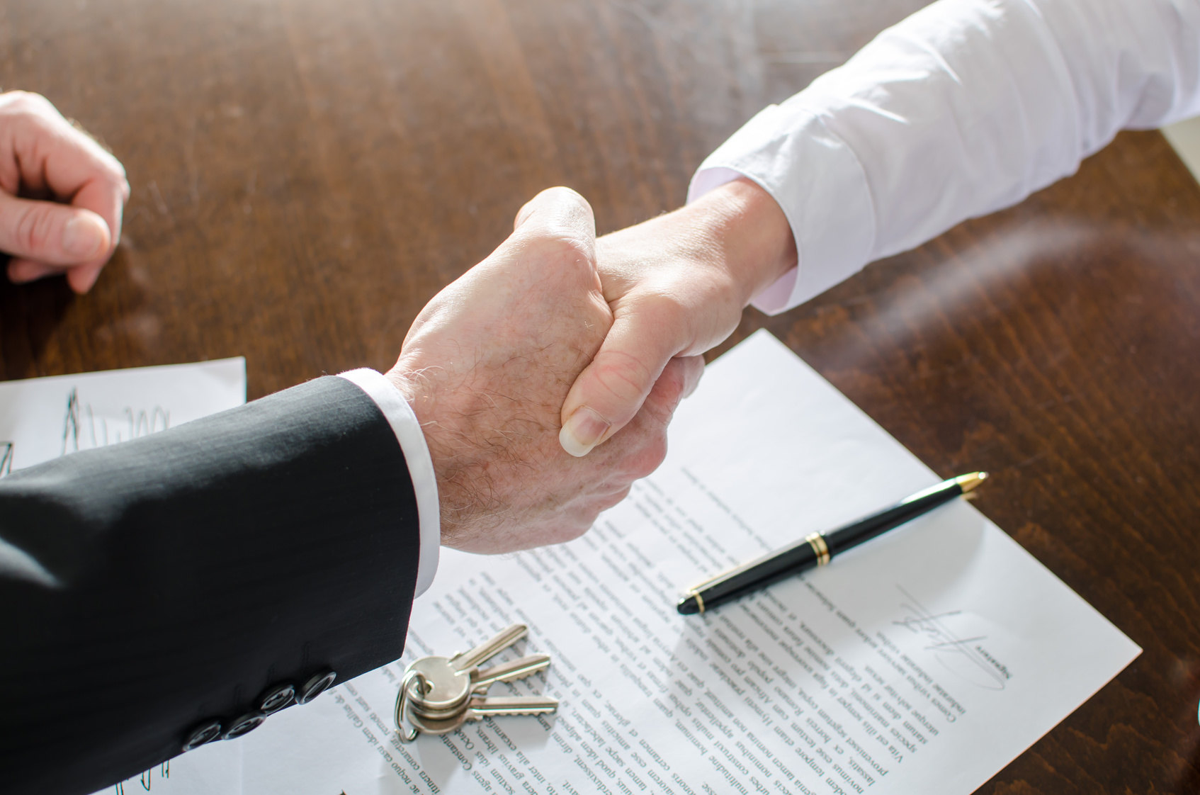 Professional Handshake Between Tenant and Landlord
